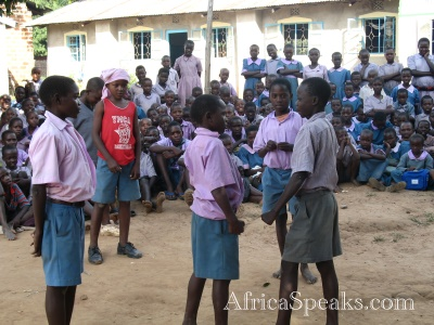 Children from Sio Primary School do a skit