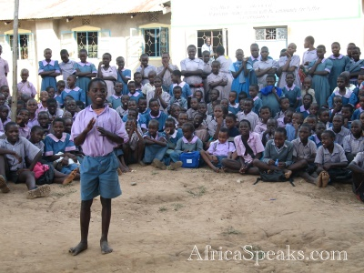 Students of the Sio R. C. Primary school look on while a HIV/AIDS skit is presented