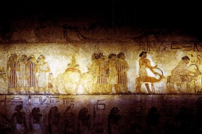 Tribute being paid in this tomb painting of khnumhotepII, 13th dynasty , governor of one of the eastern desert nomes during senusret II's reign. The paintings show a group of Hikau Khasut (rulers of foreign lands) in their brightly colored coats, coats of many colors.